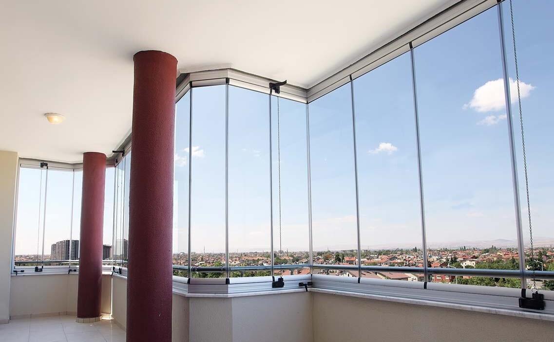 15105639935a09609956502 Современный подход к остеклению балкона Фото
