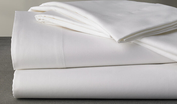 Удалить пятна от жирной кожи и неприятный запах с тканей и постельного белья