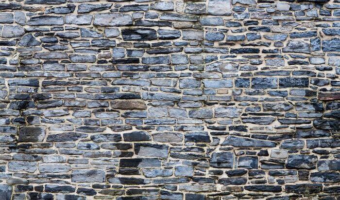 Как построить каменную стену зимой?